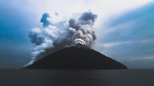 In this photo Brenton-James Glover, ash plumes rise from the volcano on Kadovar Island, Papua New Guinea in the South Pacific Sunday, Jan. 21, 2018. The island volcano erupted again Sunday, sending plumes of steam and ash into the air. Thousands of people have been evacuated from islands surrounding Kadovar Island off the South Pacific nation's north coast since the volcano there began erupting on Jan. 5. (Brenton-James Glover via AP)