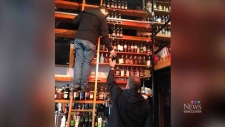 More than 200 bottles of whisky were taken from a popular bar on Commercial Drive in Vancouver during a recent raid.
