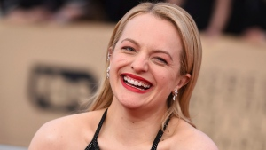 Elisabeth Moss arrives at the 24th annual Screen Actors Guild Awards at the Shrine Auditorium & Expo Hall on Sunday, Jan. 21, 2018, in Los Angeles. (Photo by Jordan Strauss/Invision/AP)
