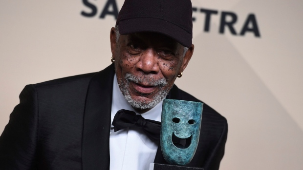 Morgan Freeman poses with his Life Achievement Award in the press room at the 24th annual Screen Actors Guild Awards at the Shrine Auditorium & Expo Hall on Sunday, Jan. 21, 2018, in Los Angeles. (Photo by Jordan Strauss/Invision/AP)