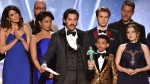 Milo Ventimiglia and the cast of 'This Is Us' accept the award for outstanding performance by an ensemble in a drama series at the 24th annual Screen Actors Guild Awards on Sunday, Jan. 21, 2018, in Los Angeles. (Photo by Vince Bucci/Invision/AP)