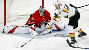 Carolina Hurricanes goaltender Cam Ward guards the post against a shot by Vegas Golden Knights' Alex Tuch during the third period of an NHL hockey game in Raleigh, N.C. on Sunday, Jan. 21, 2018. (AP Photo/Karl B DeBlaker)