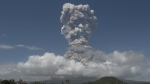 A huge column of ash shoots up to the sky during the eruption of Mayon volcano as seen from Legazpi city, Albay province, Philippines on Monday, Jan. 22, 2018. (AP Photo/Earl Recamunda)