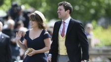 Princess Eugenie and her partner Jack Brooksbank arrive for the wedding of Pippa Middleton and James Matthews at St Mark's Church in Englefield, England on Saturday, May 20, 2017. (Justin Tallis/Pool Photo)