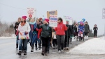 People trek down a rural road in Sandy Cove, N.S., on Saturday, January 20, 2018 in solidarity with hundreds of other marches for women's rights around the globe. (THE CANADIAN PRESS/HO, Gary Wilson)