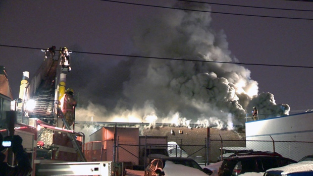 Clouds of smoke billow from a garage that was set on fire on Sunday Jan. 21, 2018 on Forest St. near Ethier St. in Montreal North (CTV Montreal/Cosmo Santamaria)