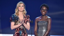 Brie Larson, left, and Lupita Nyong'o present the award for outstanding performance by a cast in a motion picture at the 24th annual Screen Actors Guild Awards at the Shrine Auditorium & Expo Hall on Sunday, Jan. 21, 2018, in Los Angeles. (Photo by Vince Bucci/Invision/AP)