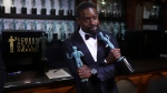 "Sterling K. Brown poses with his awards for outstanding performance by a male actor in a drama series for ""This Is Us"" and for outstanding performance by an ensemble in a drama series for ""This Is Us"" backstage at the 24th annual Screen Actors Guild Awards on Jan. 21, 2018. (Matt Sayles / Invision / AP)"