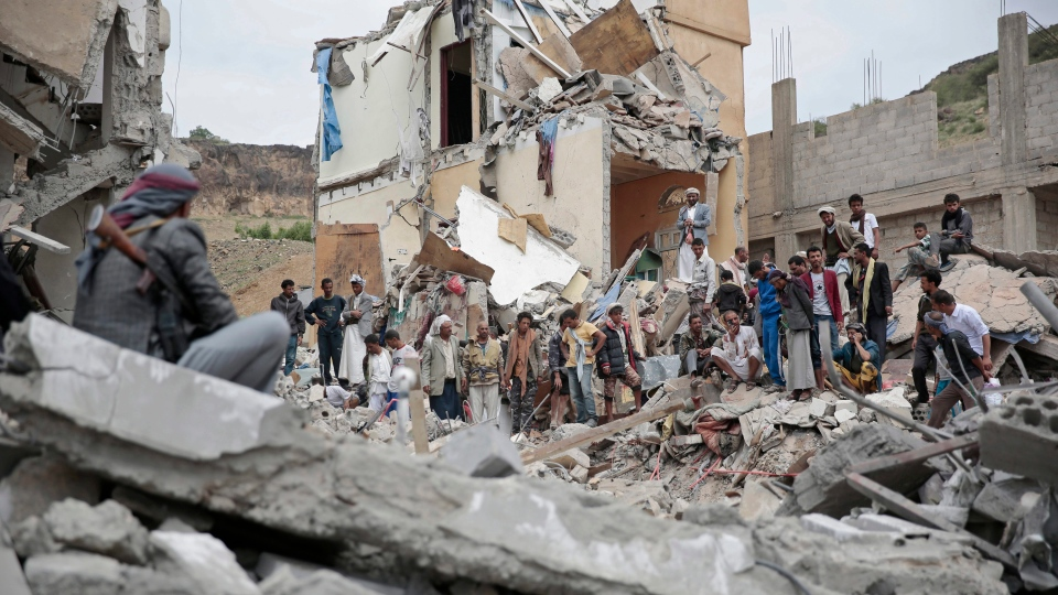 In this Aug. 25, 2017 file photo, people inspect the rubble of houses destroyed by Saudi-led airstrikes in Sanaa, Yemen. (AP / Hani Mohammed, File)