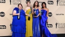"Chrissy Metz, from left, Alexandra Breckenridge, Mandy Moore, and Susan Kelechi Watson pose in the press room with their awards for outstanding performance by an ensemble in a drama series for ""This Is Us"" at the 24th annual Screen Actors Guild Awards at the Shrine Auditorium & Expo Hall on Sunday, Jan. 21, 2018, in Los Angeles. (Photo by Jordan Strauss/Invision/AP)"