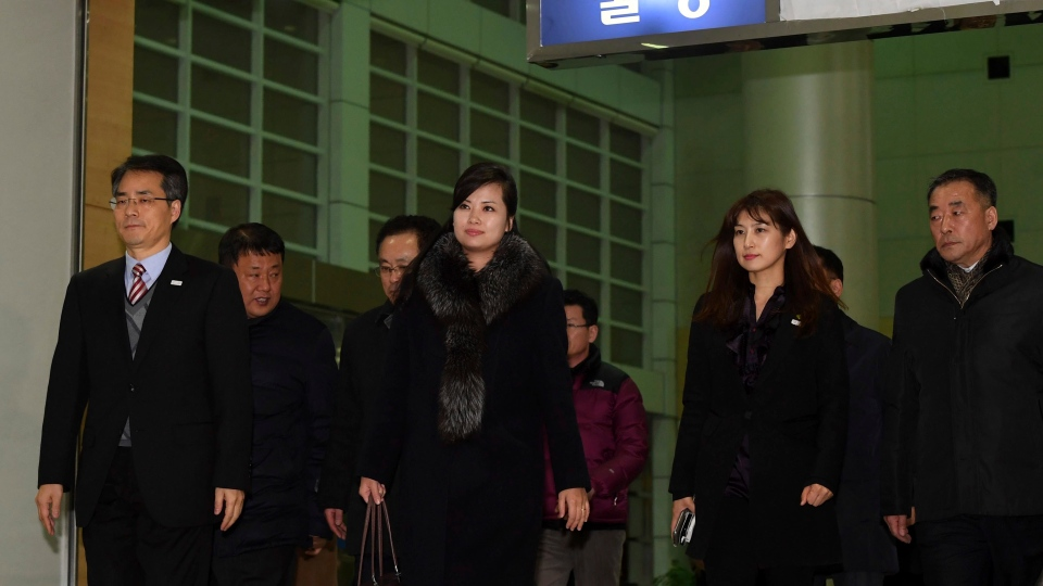 North Korean Hyon Song Wol, centre, the leader of Pyongyang's all-female Moranbong Band, leaves for North Korea at the Inter-Korean Transit Office in Paju, South Korea, Monday, Jan. 22, 2018. (Korea Pool via AP)