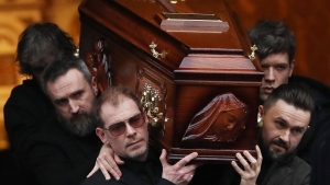 The coffin of Cranberries singer Dolores O'Riordan is removed from St Joseph's Church in Limerick, Ireland, Sunday, Jan. 21, 2018. (Niall Carson/PA via AP)
