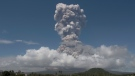 A huge column of ash shoots up to the sky during the eruption of Mayon volcano Monday, Jan. 22, 2018 as seen from Legazpi city, Albay province, around 340 kilometers (200 miles) southeast of Manila, Philippines.  (AP Photo/Earl Recamunda)