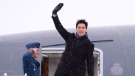 Canadian Prime Minister Justin Trudeau waves from the steps of his plane as he departs Ottawa for Davos, Switzerland for the annual World Economic Forum on Monday, January 22, 2018. (THE CANADIAN PRESS/Paul Chiasson)