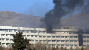 Men try to escape from a balcony of the Intercontinental Hotel after an attack in Kabul, Afghanistan, Sunday, Jan. 21, 2018. (AP / Rahmat Gul)