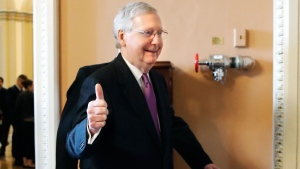 Senate Majority Leader Mitch McConnell of Ky., makes the thumbs up sign as he leaves the Senate floor after reaching an agreement to advance a bill ending the government shutdown, Monday Jan. 22, 2018, on day three of the government shutdown on Capitol Hill in Washington. (AP Photo/Jacquelyn Martin)