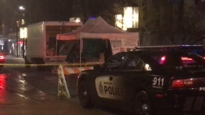 Several police vehicles park in Robson Square as officers appear to shut down makeshift pot market. (CTV)