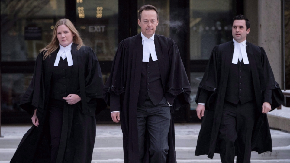 Crown prosecutor Doug Taylor, centre, leaves court after Joshua Frank and Jason Klaus were pronounced guilty by a judge in Red Deer, Alta., on Jan. 10, 2018. (THE CANADIAN PRESS/Jeff McIntosh)
