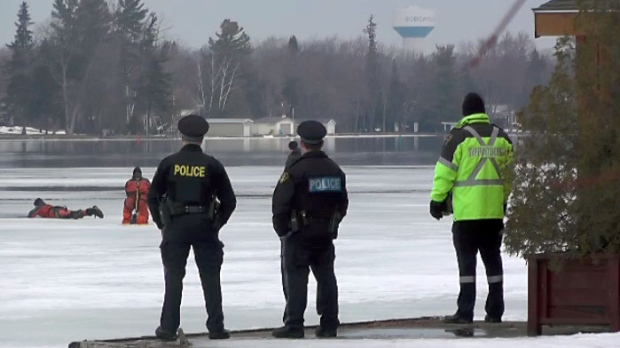 Teams search for the body of a missing snowmobiler on Lake Sturgeon.