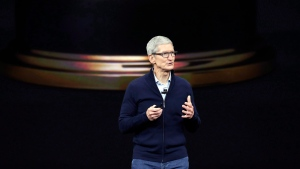 Apple CEO Tim Cook, shows new Apple Watch Series 3 product at the Steve Jobs Theater on the new Apple campus on Tuesday, Sept. 12, 2017, in Cupertino, Calif. (THE CANADIAN PRESS / AP, Marcio Jose Sanchez)