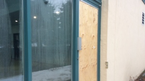 Several windows were smashed during break-ins in Barrie, Ont. This boarded up window can be seen on Monday, Jan. 22, 2018. (Rob Cooper/ CTV Barrie)