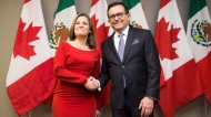 Minister of Foreign Affairs Chrystia Freeland (left) poses for a photo before holding a bilateral meeting with Mexico's Secretary of Economy Ildefonso Guajardo Villarreal in Toronto on Monday, January 22, 2018. THE CANADIAN PRESS/Michelle Siu