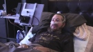 A man with ALS uses a special device to communicate