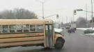School bus cuts across traffic