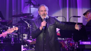 This Feb. 11, 2017, file photo shows Neil Diamond performing at the Clive Davis and The Recording Academy Pre-Grammy Gala at the Beverly Hilton Hotel in Beverly Hills, Calif. (Photo by Chris Pizzello/Invision/AP)