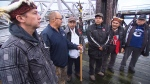 Members of B.C. First Nations deliver an eviction notice to a fish farm operated by Marine Harvest on Jan. 22, 2018. (CTV Vancouver)