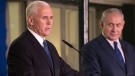 U.S. Vice President Mike Pence delivers a statement as Israel's Prime Minister Benjamin Netanyahu listens at the Prime Minister's residence in Jerusalem, Monday, Jan. 22, 2018. (AP Photo/Ariel Schalit, Pool)