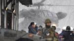 Japan Ground Self-Defence Force helicopter on a rescue operation at a ski resort in Kusatsu, Japan, Jan. 23, 2018. (Muneyuki Tomari / Kyodo News via AP)