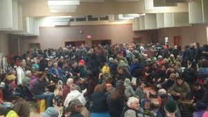 Hundreds of people crammed into the Tofino Community Hall after a tsunami warning was issued for coastal areas of B.C. following a large earthquake off the Alaskan coast. Jan. 23, 2018. (Twitter/@Cat_Lempke)