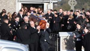 Pallbearers carry the coffin of Cranberries singer Dolores O'Riordan during her funeral at Saint Ailbe's Church, Ballybricken, Ireland, Tuesday Jan. 23, 2018. (Niall Carson/PA via AP)