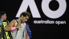 Rafael Nadal leaves Rod Laver Arena after withdrawing injured from the Australian Open, on Jan. 23, 2018. (Dita Alangkara / AP)