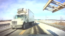 The truck driver eventually steered the vehicle into the proper lane.