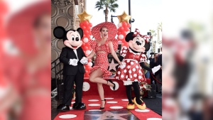 Mickey Mouse, from left, Katy Perry and Minnie Mouse attend a ceremony honoring Minnie with a star on the Hollywood Walk of Fame on Monday, Jan. 22, 2018, in Los Angeles. (Photo by Richard Shotwell/Invision/AP)