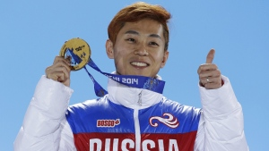 Viktor Ahn during a medals ceremony at the Winter Olympics in Sochi, Russia, on Feb. 15, 2014. (David J. Phillip / AP)