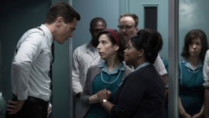 This image released by Fox Searchlight Pictures shows Michael Shannon, from left, Sally Hawkins and Octavia Spencer in a scene from the film, 'The Shape of Water.' Guillermo del Toro's Cold War fantasy tale will vie for the most nominations for the 90th annual Academy Awards. (Fox Searchlight Pictures via AP)