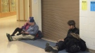 Jan Knutson, left, and her husband Ed Hutchinson, center, and a man at about 2:30 a.m. Tuesday, Jan. 23, 2018, wait for the all-clear at Homer High School during a tsunami alert for Homer, Alaska. The city of Homer issued an evacuation order for low-lying areas shortly after an earthquake hit. (Michael Armstrong/Homer News via AP)