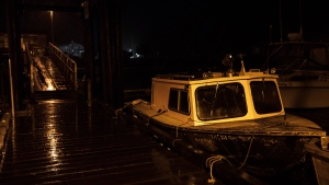 Fishing boats on the fourth street dock in Tofino sway from side-to-side with the heavy rain and wind after the tsunami warning ends, on Tuesday, Jan. 23, 2018. THE CANADIAN PRESS/Melissa Renwick