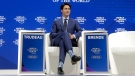 Prime Minister Justin Trudeau sits on the podium prior to his special address on corporate responsibility and the role of women in a changing world during the annual meeting of the World Economic Forum in Davos, Switzerland, Tuesday, Jan. 23, 2018. (AP Photo/Markus Schreiber)