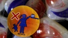 A warning label is attached to a package of Tide laundry detergent packets in Houston on Thursday, May 24, 2012. (THE CANADIAN PRESS/AP/Pat Sullivan)
