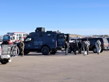 CPS, EMS, CFD, City of Calgary Bylaw, RCMP, and Alberta Fish and Wildlife representative at a staging area in southwest Calgary on January 23, 2018