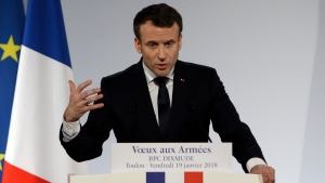 French President Emmanuel Macron presents his New Year wishes to the French military forces onboard the assault ship Dixmude docked in the French Navy base of Toulon, southern France, Thursday, Jan. 19, 2018. (AP Photo/Claude Paris, Pool)