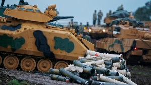 Turkish soldiers prepare their tanks to enter combat and join a military offensive on a Kurdish-held enclave in northern Syria, at a staging area in the Hatay province,Turkey near the the border with Syria. (Lefteris Pitarakis/AP Photo)