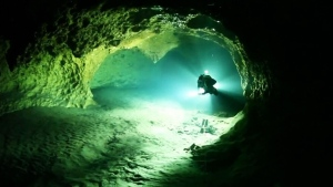 A scuba diver is seen swimming through an underwater cave is seen in this file image.