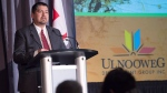 Chris Googoo, chief operating officer of the Ulnooweg Development Group, addresses the audience in Halifax on Tuesday, Jan. 23, 2018. (THE CANADIAN PRESS / Andrew Vaughan)