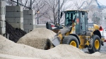 A city worker piles road salt on a mound at a city municipal depot in Montreal, Tuesday, January 23, 2018. (Graham Hughes/THE CANADIAN PRESS)