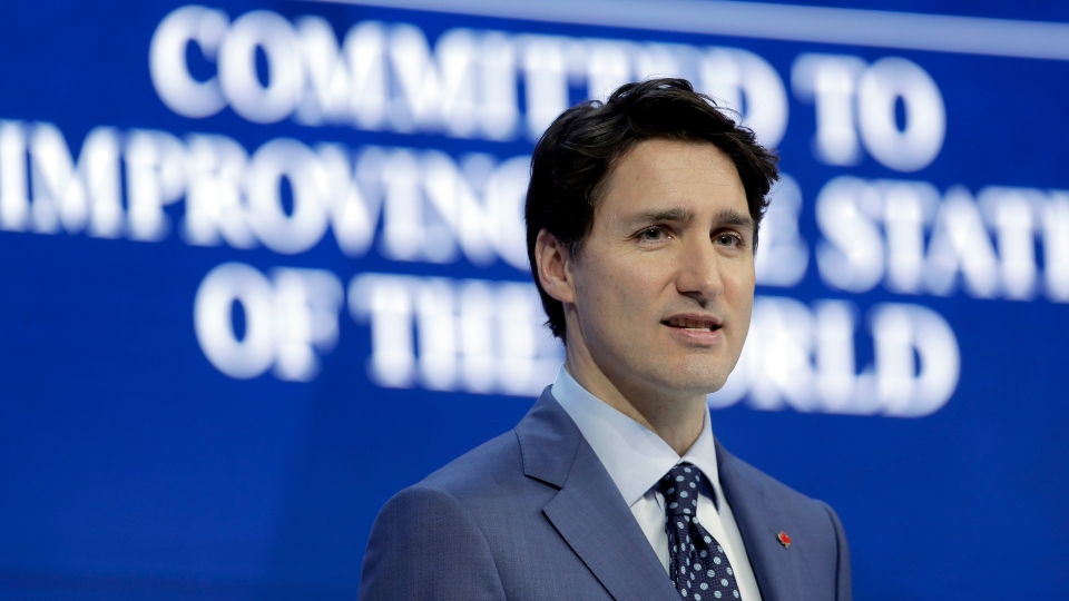 Prime Minister Justin Trudeau looks to the audience during an address at the World Economic Forum in Davos, Switzerland, Tuesday, Jan. 23, 2018. (AP Photo/Markus Schreiber)